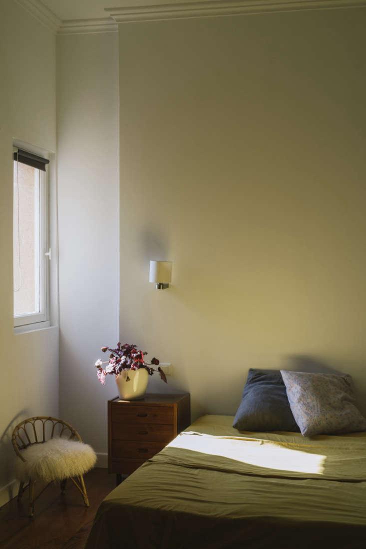 La Vie en Rose Inside a Costumiers Dreamlike DIY Maison in France A sheepskin in another sunlit bedroom.
