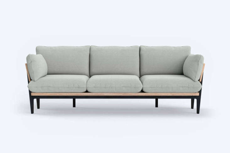 The Floyd Sofa Wood Frame comes as a two-, three-, and three-seater with chaise in four options for upholstery and a wood base; $loading=
