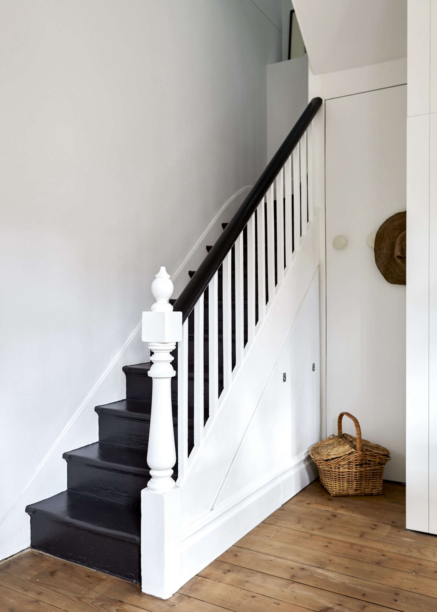 The interior had been largely stripped of original detailing and lacked a kitchen, but the entry retained its original stair and Baltic pine floor, which was replicated elsewhere. (Scroll down to see some Before shots.) Whiting used the space under the stairwell for &#8