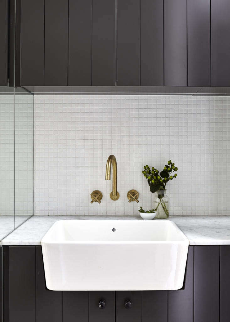 Like the kitchen, the powder room has a classic Shaw&#8