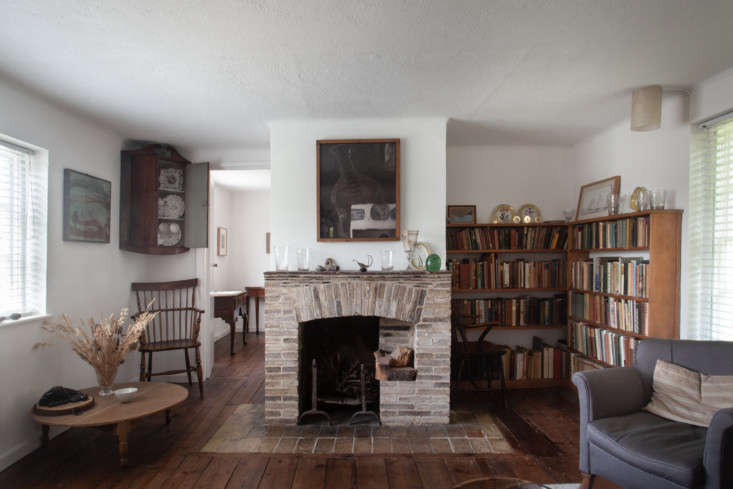 A view of the second fireplace and reading corner in the upstairs level of the old cottage.