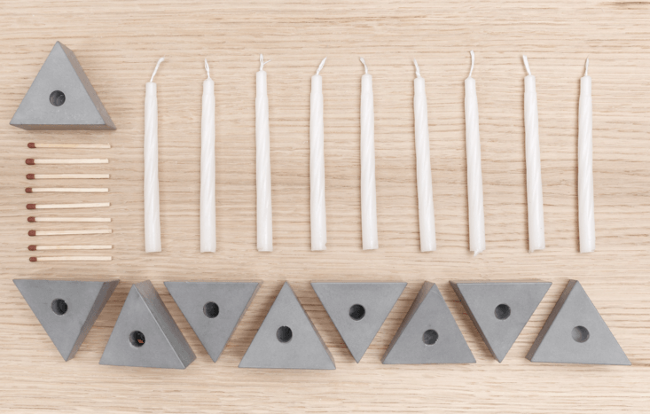 Made by Planbureau, a Budapest design collective, the Logifaces Menorah is a puzzle-like set of eight angled concrete pieces plus one flat-topped shammashthat can be put together in myriad combinations, including a Jewish star. It&#8