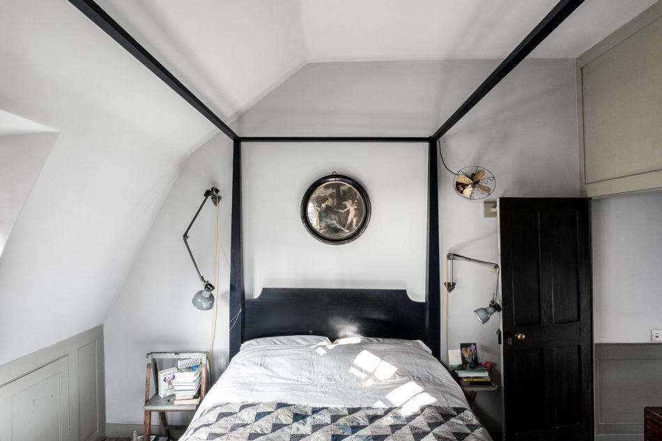 A bedroom on the top floor. Note the artful placement of the bedside sconces.