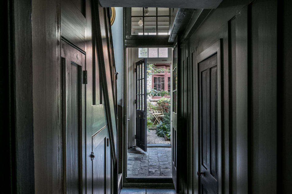 A narrow hall leads to a small garden in the back of the house.