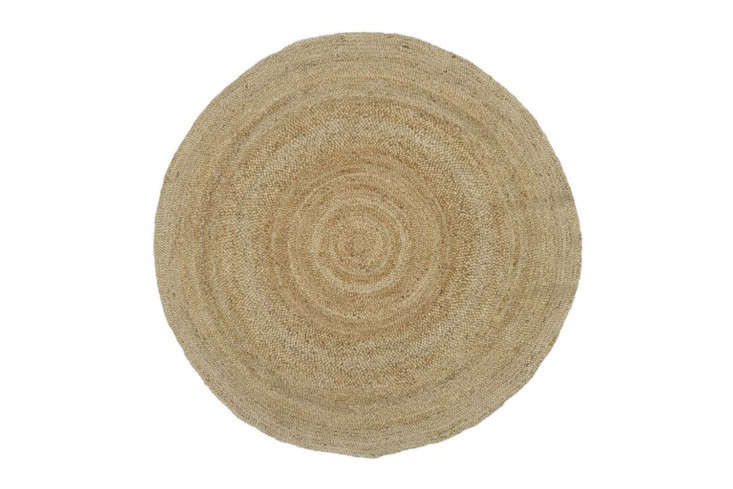 the pottery barn 8 foot round jute rug in natural is \$\299. 20