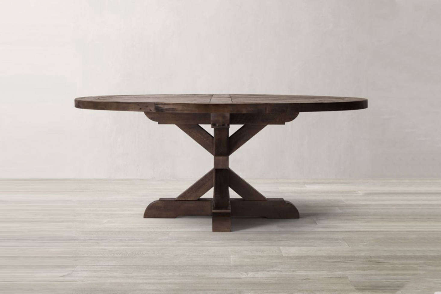 Another off-the-shelf option is the Restoration Hardware Salvaged Wood X-Base Round Dining Table which starts at $