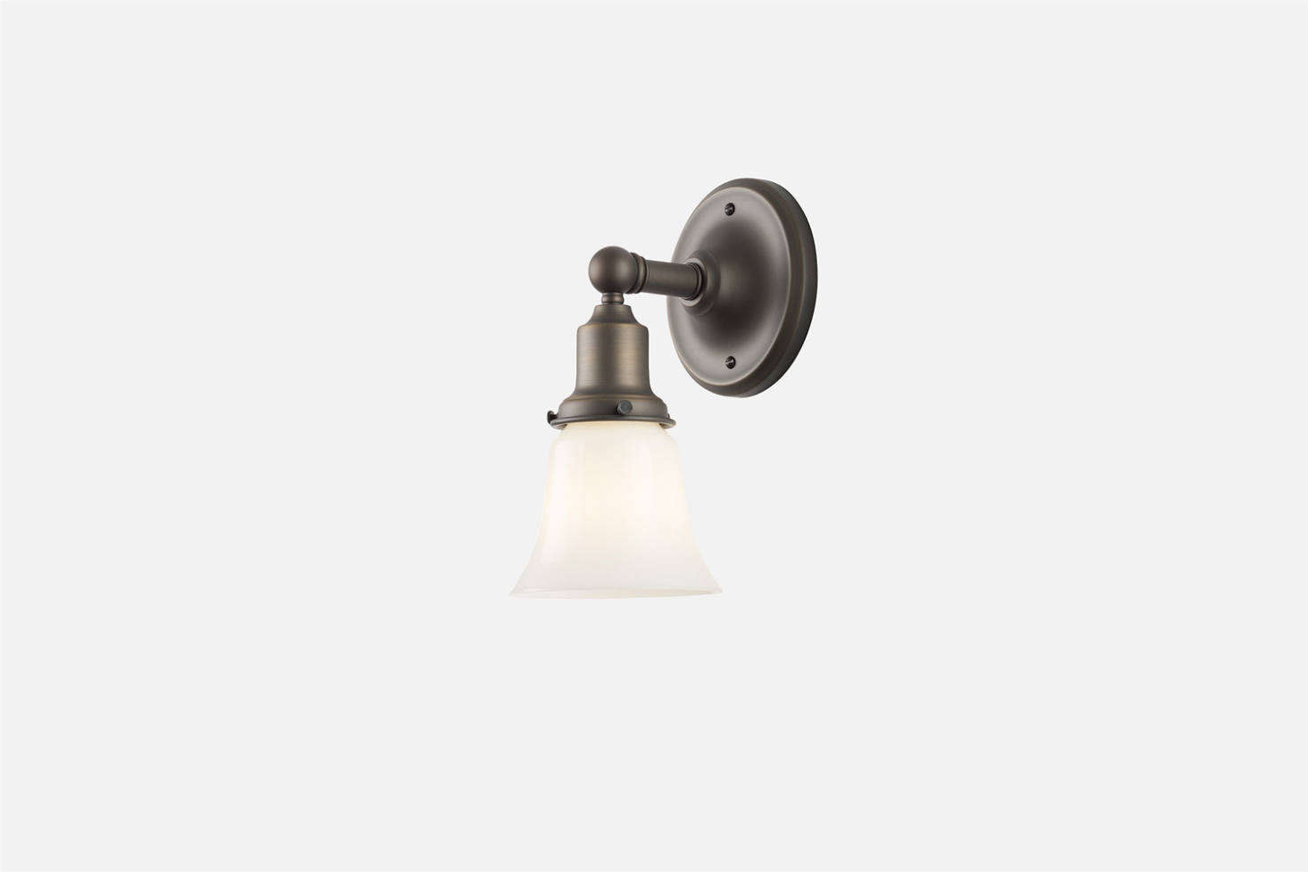The Schoolhouse Irvine Single Sconce, shown in Matte Bronze, can be paired with any Schoolhouse lampshade; $9. It&#8
