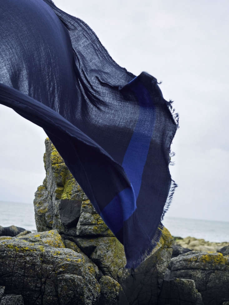 The lightweight Voyage Washed Cashmere Travel Blanket, shown in Marine, can be used as both a shawl or a blanket;£490.