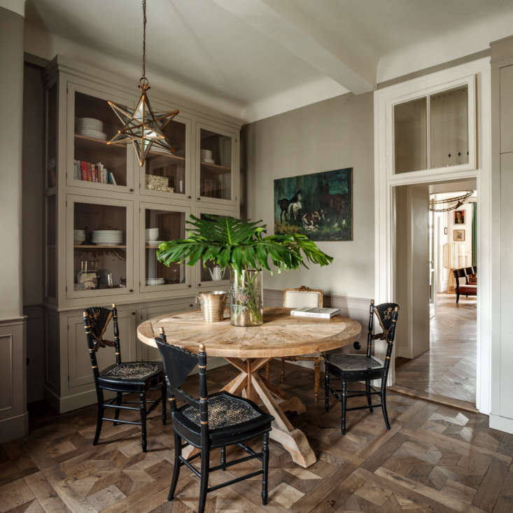 The oak flooring in the rest of the home is laid in Hungarian point, but Chrapka chose an etoile pattern for the kitchen.