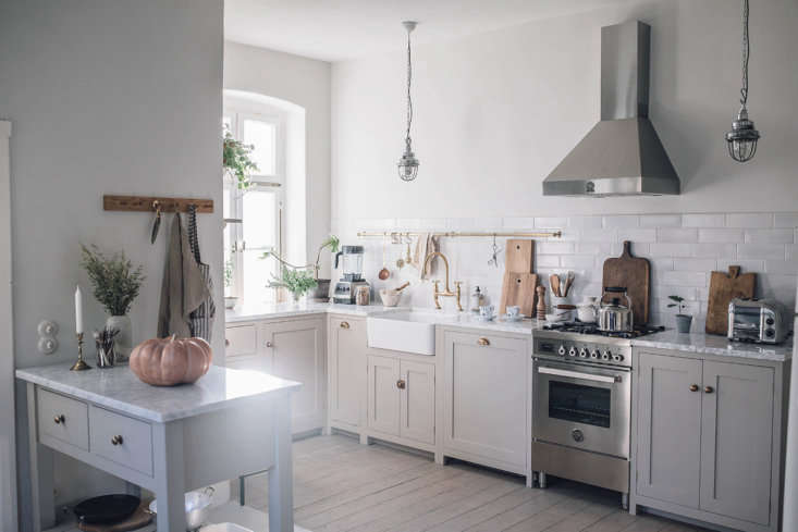 Standard, modular cabinets from deVol&#8\2\17;s Real Shaker Kitchen line arrived from the company&#8\2\17;s workshop in Cotes Mill, England. Laura and Nora came up with the layout themselves and worked with deVol&#8\2\17;s design team remotely: &#8\2\20;they reply unbelievably fast to emails.&#8\2\2\1; A local crew took down the wall—&#8\2\2\1;we were lucky, no extra supports were required&#8\2\2\1;—and did the installation work.