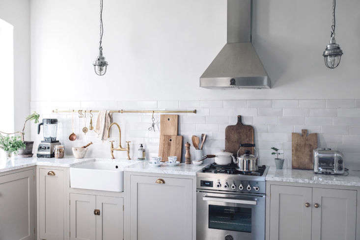 &#8\2\20;Before our kitchen was all black; this time we really wanted to create another look and go for the opposite,&#8\2\2\1; says Laura. The cabinets—made of high-grade birch ply with tulipwood and maple fronts—are painted a color deVol calls Mushroom.