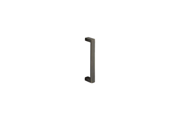 The Emtek Bronze Rustic Modern Rectangular Door Pull is also available in black and tumbled white bronze; $95. at Build.com.