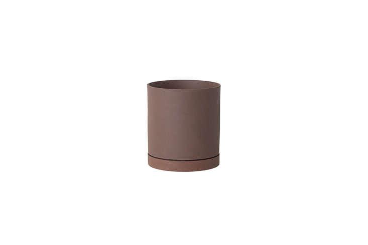 the ferm living medium sekki pot in rust is \$33.40 at finnish design shop. 30