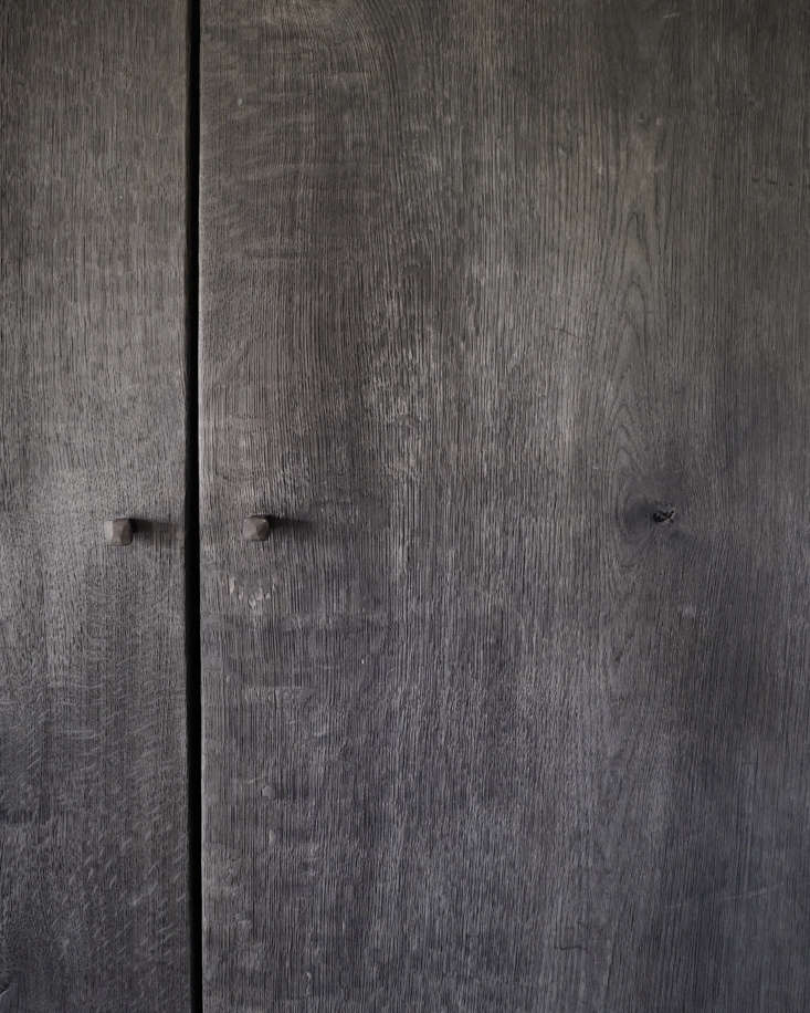 Hand-forged nails serve as knobs on the bedroom wardrobes made by Belgian designer/reclamation dealer Joris Van Apers.