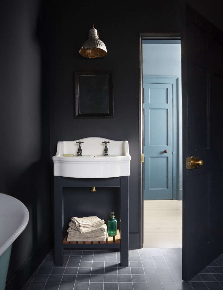 Mamma Mia Music Producer Nick Gilpins Stylishly Revived Georgian Manse Harding assembled the guest bath&#8\2\17;s sink, taps, bathtub, and mercury glass light from &#8\2\20;various antiques shops and salvage yards.&#8\2\2\1; She painted the room Farrow & Ball Railings and the tub turquoise.