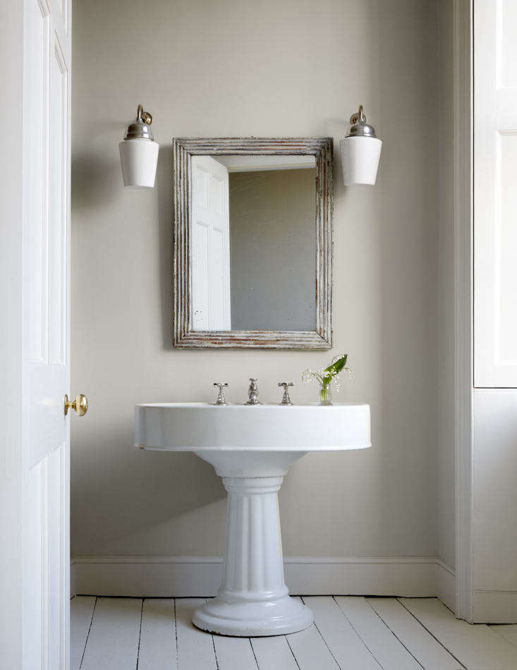 Mamma Mia Music Producer Nick Gilpins Stylishly Revived Georgian Manse The master bath&#8\2\17;s stately sink came from a reclamation yard. The mirror is also antique and the Bone China Wall Lights are from Felix Lighting.
