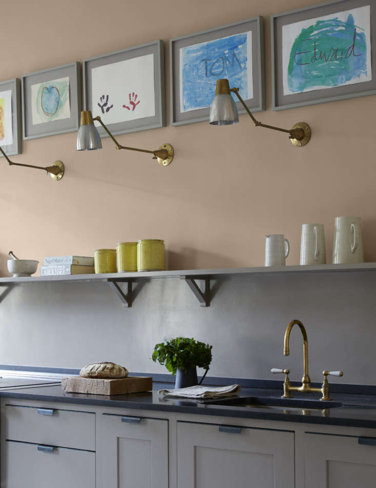 Harding led an art workshop with the Gilpin kids and hung the results high in a row over the sink counter. &#8