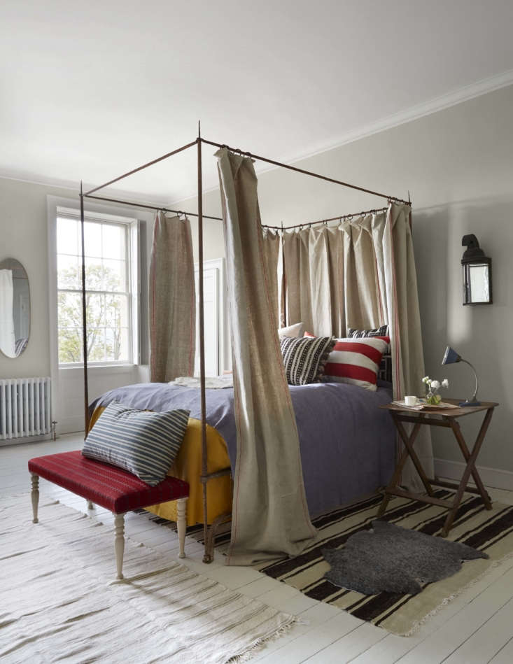 Mamma Mia Music Producer Nick Gilpins Stylishly Revived Georgian Manse The main guest room features a canopy bed of wrought iron based on a \17th century Italian original: &#8\2\20;It took me years to find a blacksmith with the skill and courage to make it,&#8\2\2\1; Howe tells us. The bed curtains are linen as is the hand dyed lavender bedspread; both are from Howe&#8\2\17;s vintage fabrics offshoot,Howe at 36 Bourne Street.