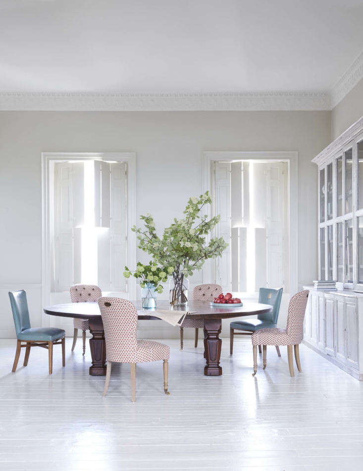 The rear of the room is used as a dining area. The nine-foot Holland & Sons mahogany table dates to the 60s and Howe, says, was probably made for a government building or library. Harding chose to go rug-free here to preserve the sense of space and to &#8