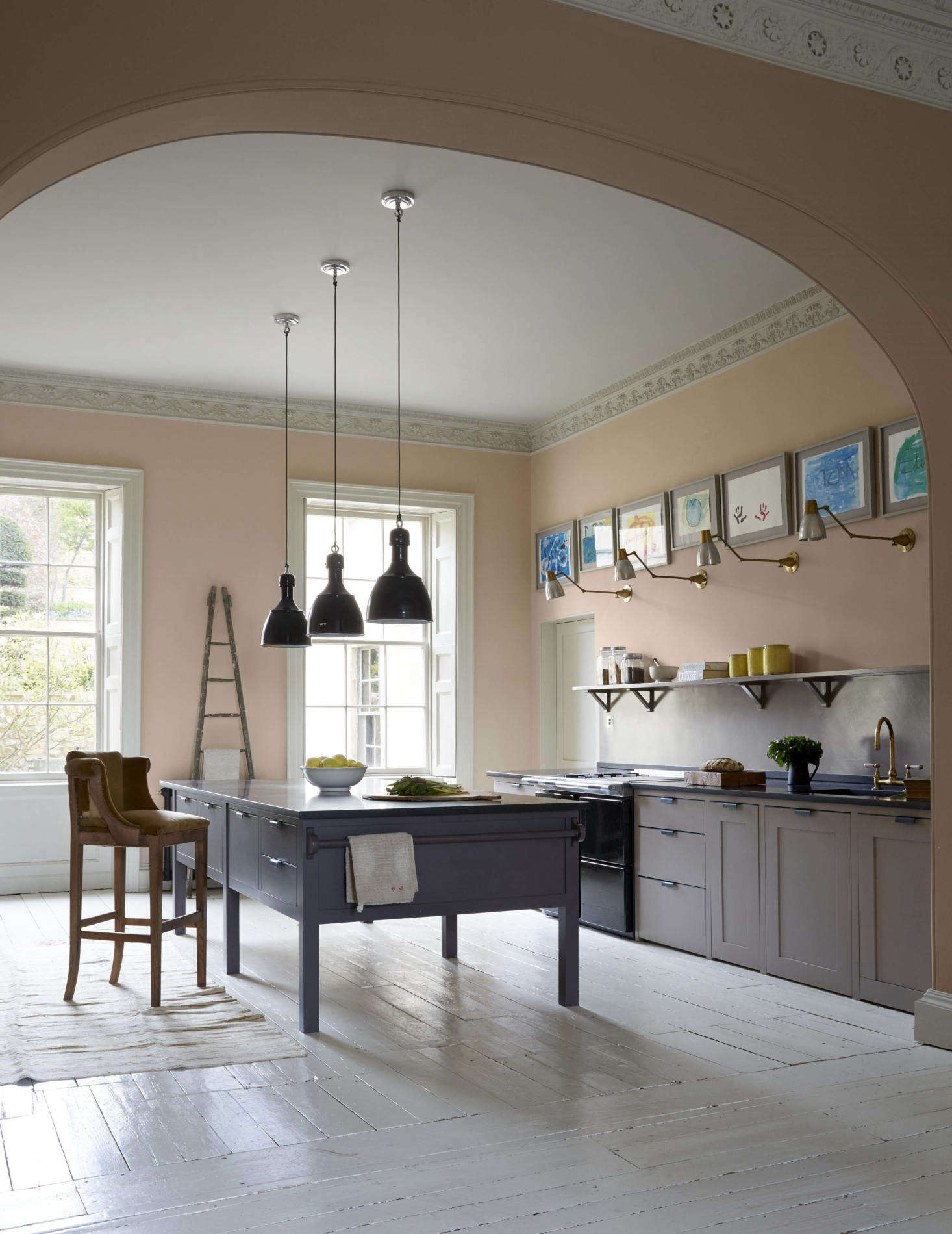 An eggshell (Estate Emulsion) finish of Farrow & Ball pink is on the walls with a glossy finish of the company&#8