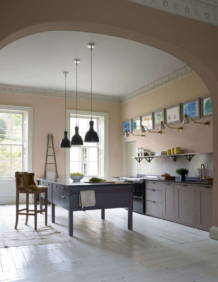 The ballroom-scaled kitchen is fitted with a work island and cabinets fromPlain English, which straddle the line between classic and contemporary. The walls are painted Setting Plaster, a Farrow & Ball pale pink that Harding says is her favorite color to live with: &#8