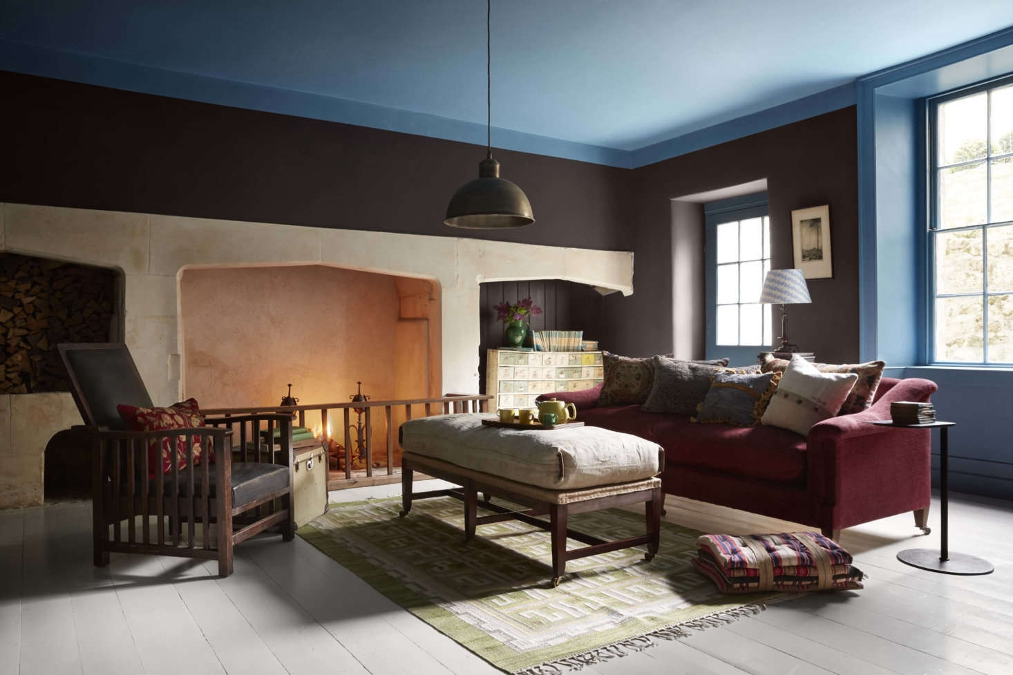 The kitchen was originally set downstairs in the partially above-ground basement, now used as a family room or &#8