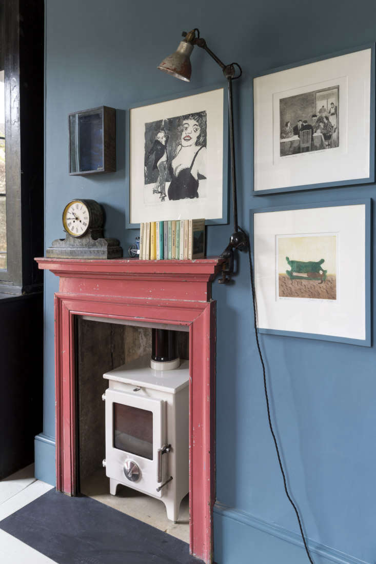 Mamma Mia Music Producer Nick Gilpins Stylishly Revived Georgian Manse An antique mantel in its original paint was added to the room along with a wood burning stove and vintage workman&#8\2\17;s light. Photograph by Claudia Rocha courtesy of Howe London.