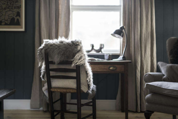 A small writing desk in the third bedroom, outfitted with sheepskin.