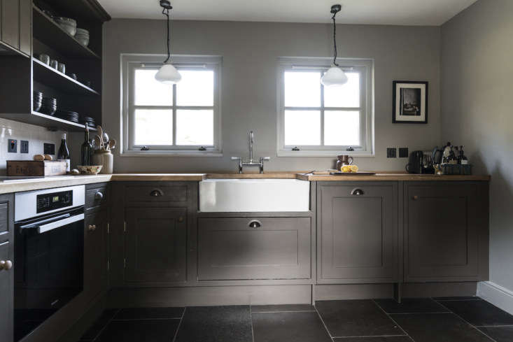 There was no kitchen in the cottage as it was, so the team hired a local Scottish craftsman to build one with modern amenities and references to tradition. The cabinets are painted in a hue by Farrow & Ball.