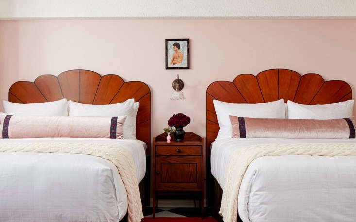 Guest rooms feature scalloped wood headboards and artwork that pays tribute to the some of the university&#8