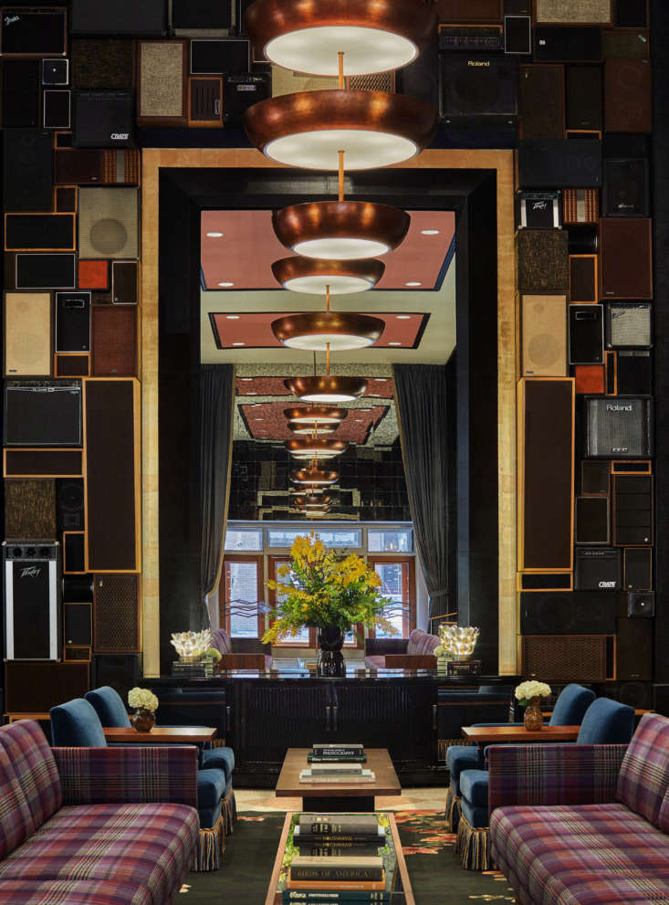A soaring ceiling in the lobby creates a dramatic space, complete with a two-story wall installation of vintage amps and speakers, a reference to Seattle&#8