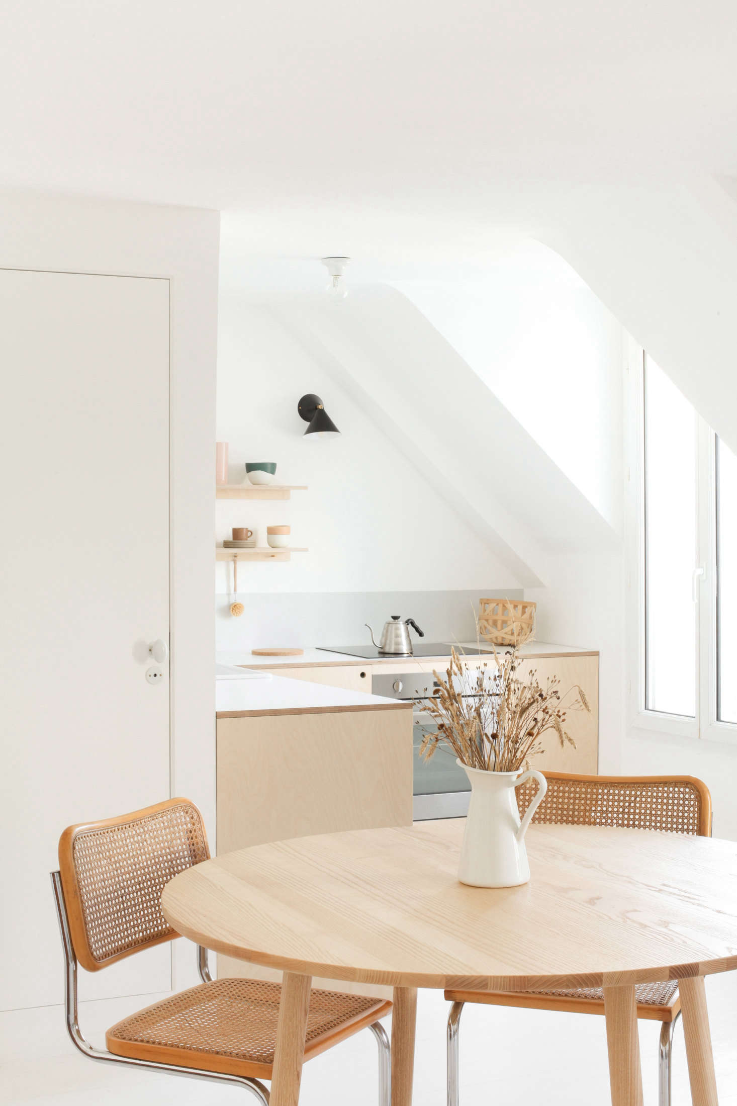 Their one splurge was the handmade dining table fromStattmann Neuemoebel (see below) paired with two vintage Cesca chairs they already had. For the full breakdown of costs see our postKitchen of the Week: Two Young Paris Architects Completely Redo Their Kitchen for Under $4,300.
