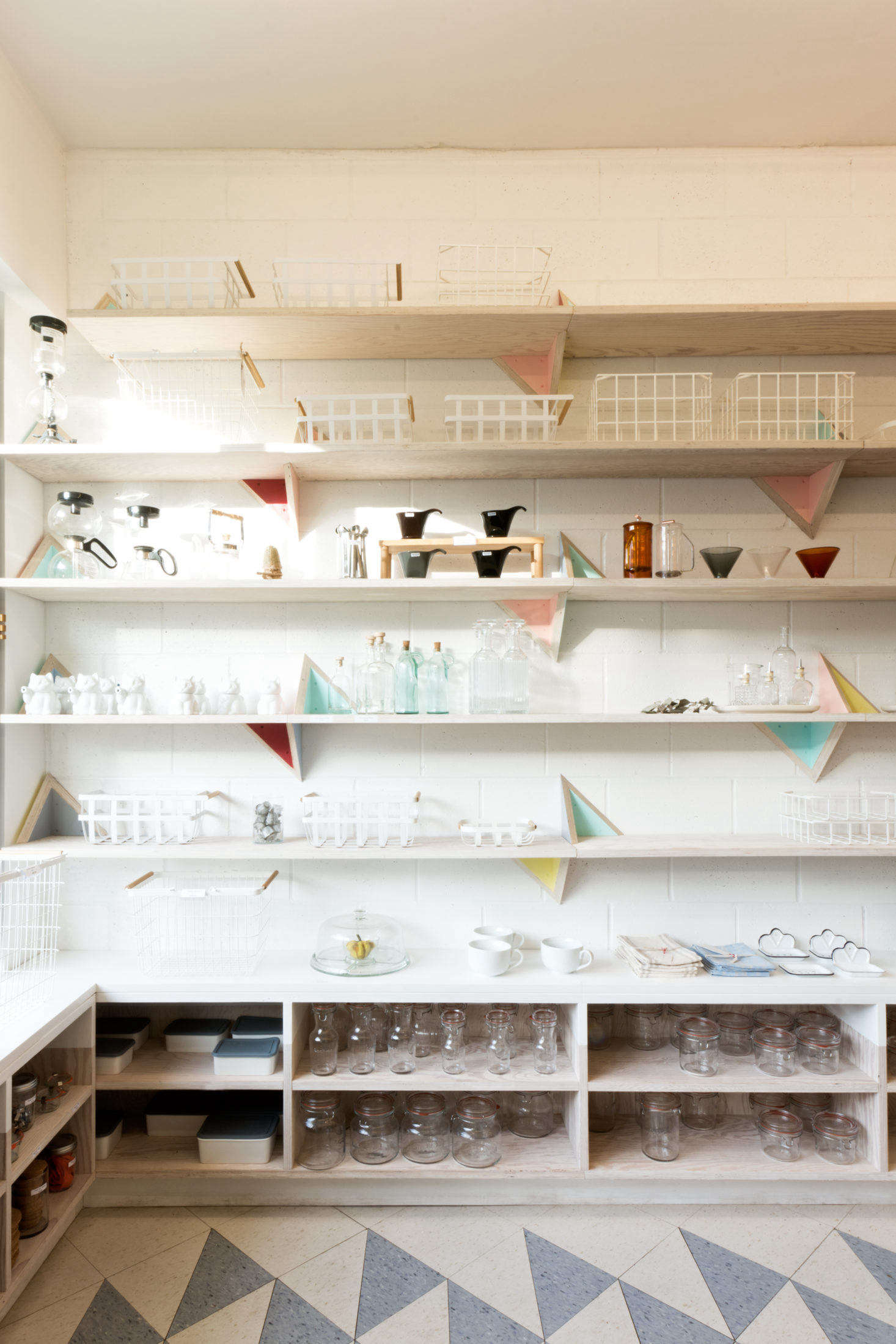 A curated selection of non-plastic kitchen essentials is displayed on regionally sourced Douglas fir plywood shelving.