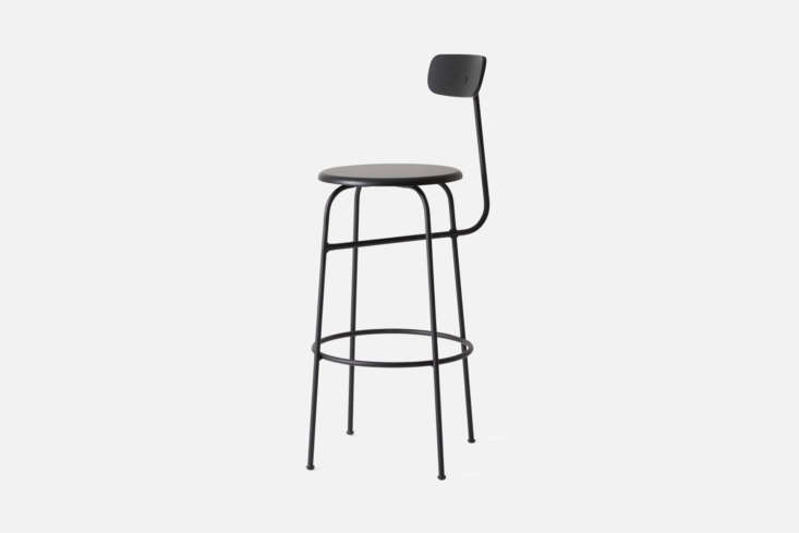 The barstools around the custom kitchen island are the Menu Afteroom Bar Chairs in Black for $449.95 at Menu.