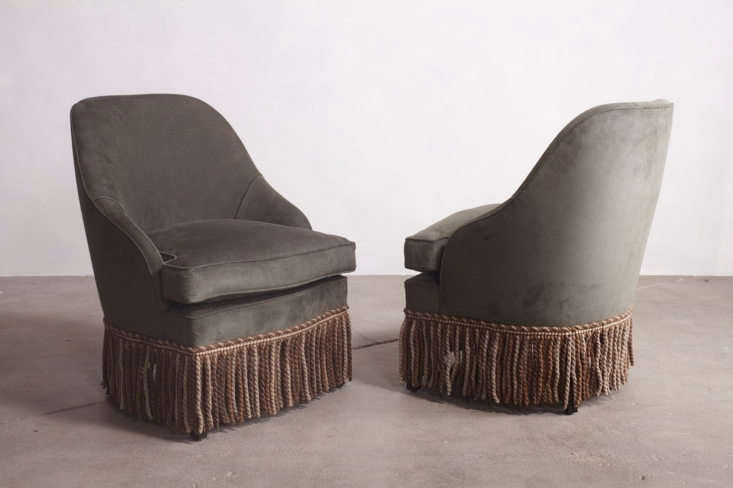 Spotted everywhere lately: fringe-trimmed lounge chairs; shown above is a pair of Cover Fireplace Pull-Up Chair with wool bullion fringe skirting from LA designers Nickey Kehoe.