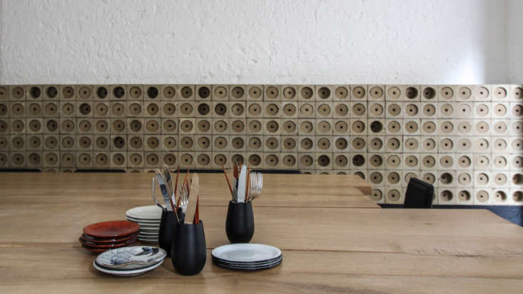 In the cafe, wine storage doubles as an art installation, designed and fabricated by Brittany-based ceramist Philippe Josse.