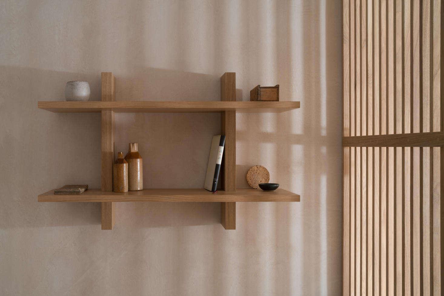 Oak shelving in the bedroom.