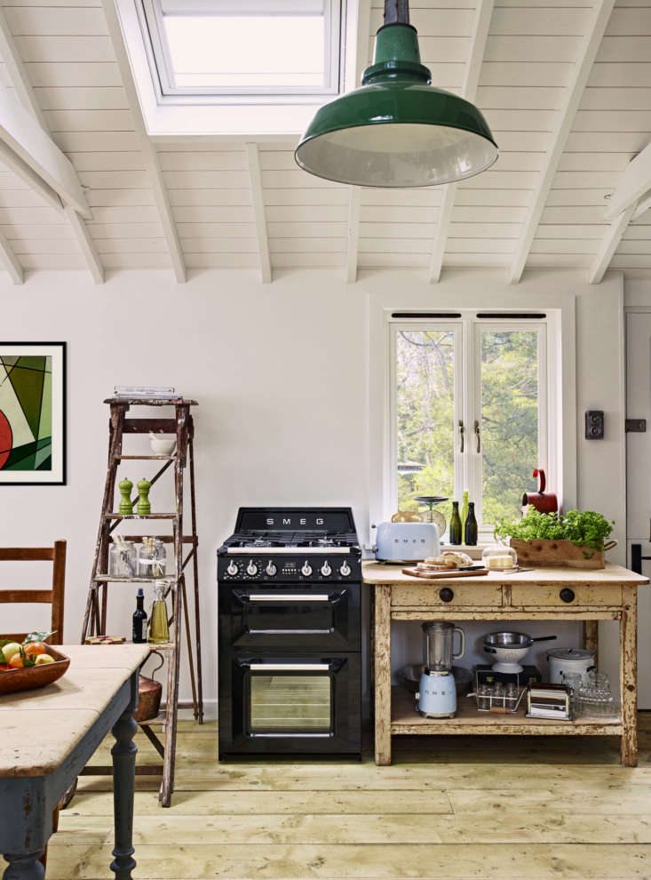 A country-style kitchen with appliances from Smeg.