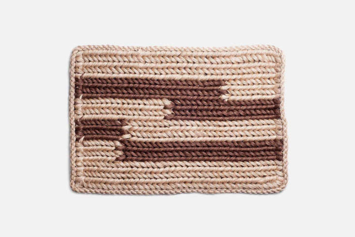 the knotted doormat in walnut stripe is on sale for \$\100 on someware; garment 11