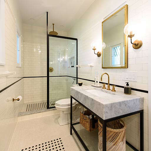 Classic white subway tiles line the walls of a bathroom. Photograph courtesy of Subway Ceramics.