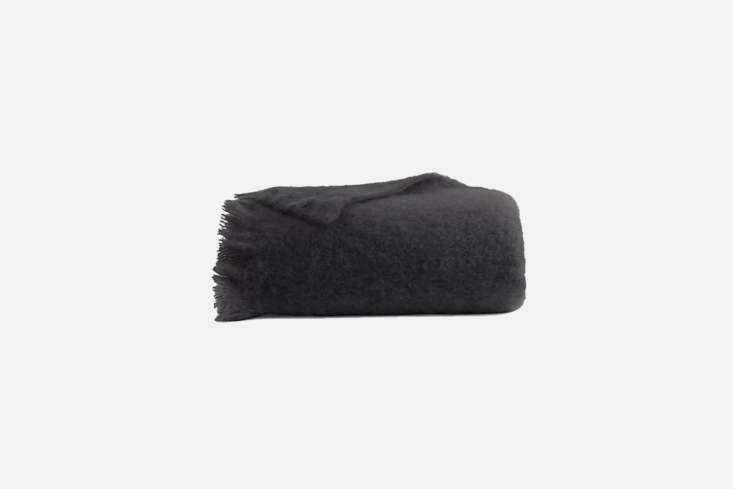 Available at Design Within Reach, the Mohair Throw designed by Amanda Pratt comes in standard black (Charcoal) and white (Cream); $5 at DWR.