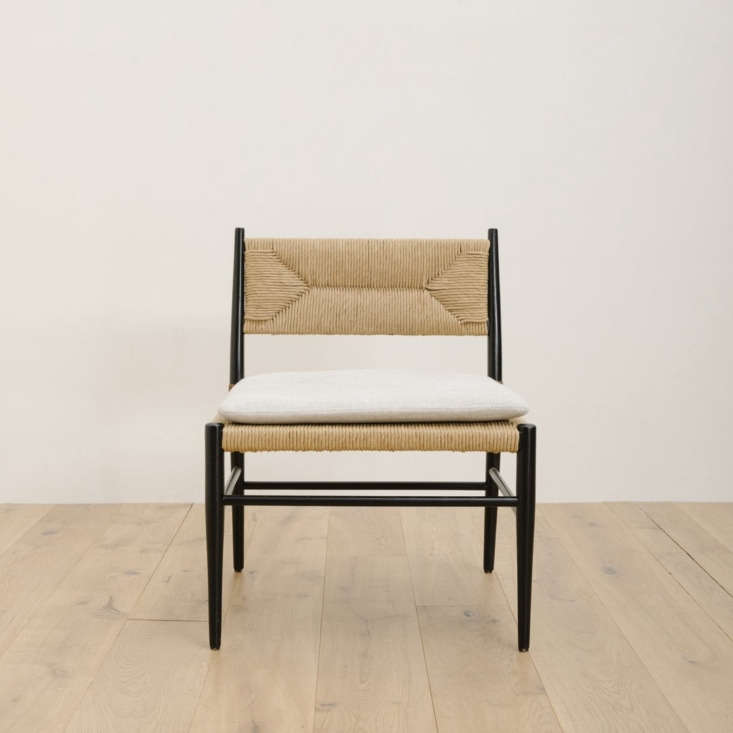 the mulholland lounge chair has an oak frame and hand woven rush seat. a rustic 15