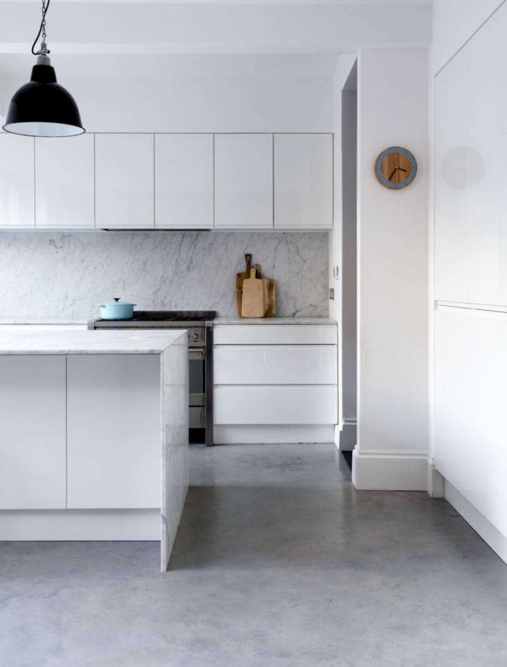 A minimalist indoor-outdoor marble kitchen by owners of a semidetached Victorian in Dulwich, South London. For more, see Kitchen of the Week: The Ultimate Indoor-Outdoor Kitchen.Photograph courtesy ofJJ Locations.
