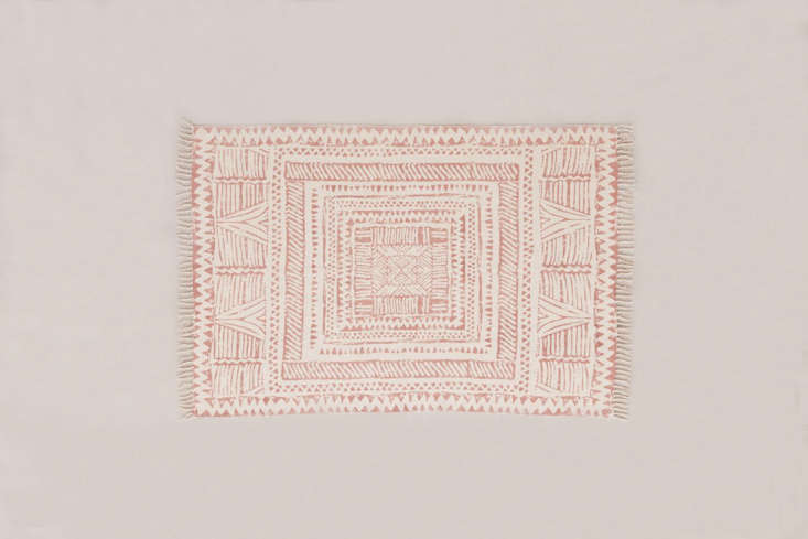 the ari block printed rughas a graphic print in salmon; starting at \$99 from 11