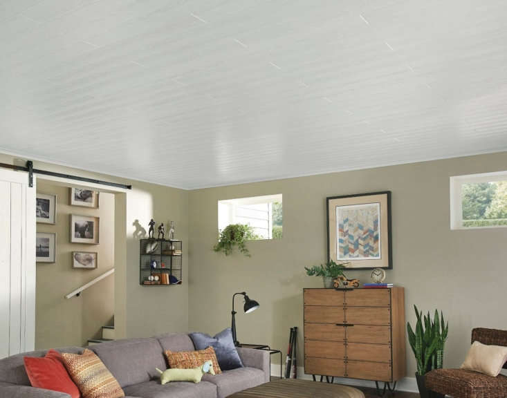 Remodeling Hack An Easy and Affordable Way to Update Your Basement This basement has an unexpectedly airy feel thanks to Armstrong Ceilings&#8\2\17; Classic White planks.