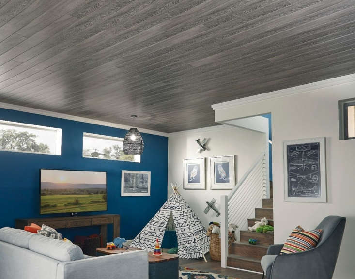Remodeling Hack An Easy and Affordable Way to Update Your Basement The WoodHaven Driftwood Gray plank achieves the look of salvaged wood without the expense.