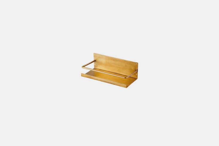 our favorite new find: the petite brass shelf, with a slim ledge and a rod to k 9