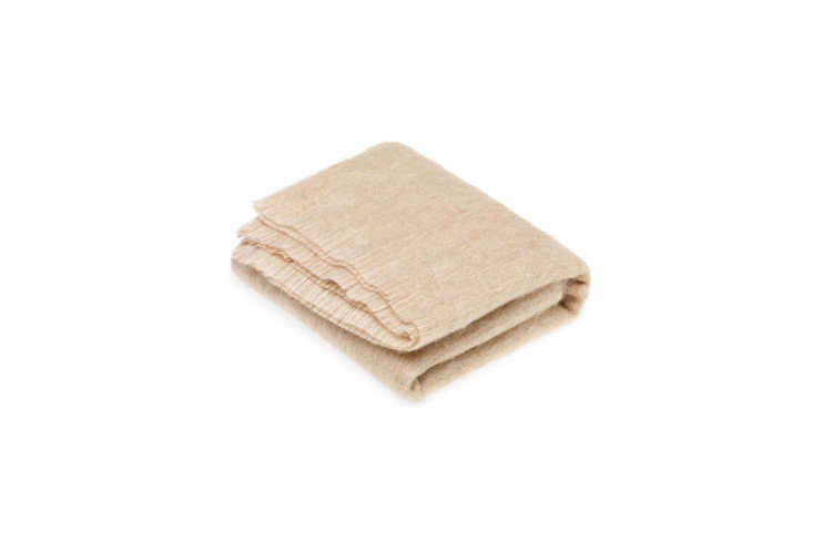 The Bronte Bronte Mohair Throw in Blonde is £89.95 at Lux Deco.