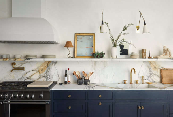 The Parisian-style open shelving kitchen of life-style bloggerAthena Calderone and her husband Victor featuresCalacatta Paonazzo marble counters paired with chalky gray cabinetry. The couple collaborated with Elizabeth Roberts on the architectural design. See more of the kitchen via Calderone&#8
