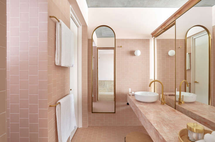 tiled pink walls and a floating vanity of pink marble at the richards and spenc 11